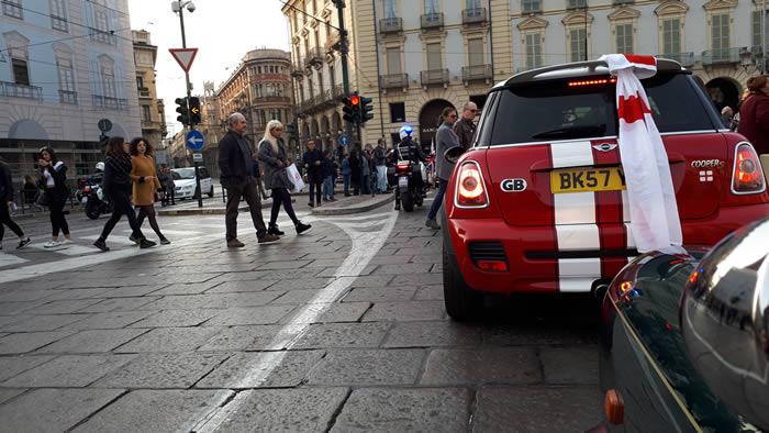 Police escort through Turin